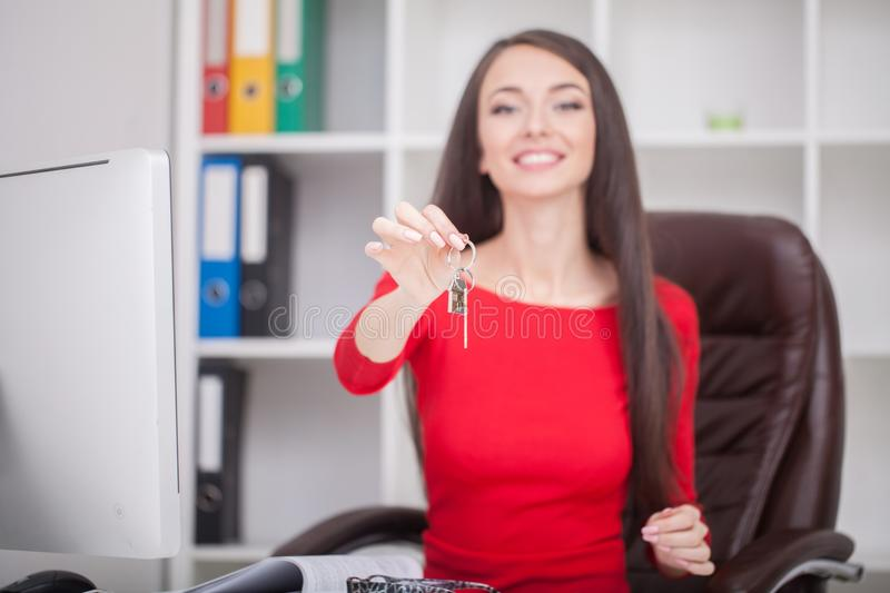 Real estate agent giving house keys to a customer royalty free stock images