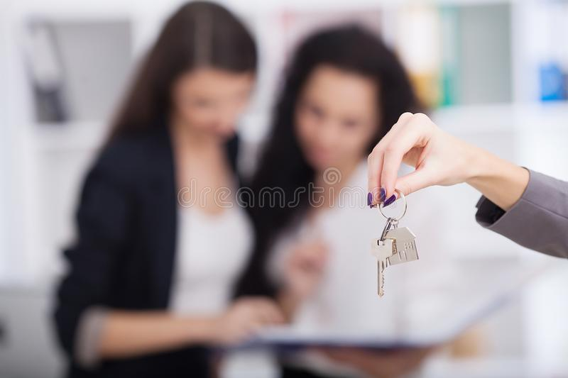 Real estate agent giving house keys to a customer royalty free stock photo