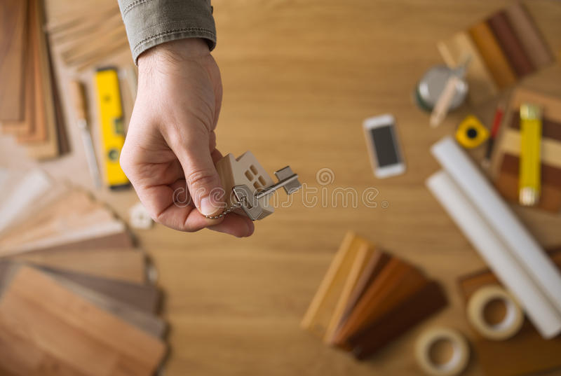 Real estate agent giving house keys royalty free stock image
