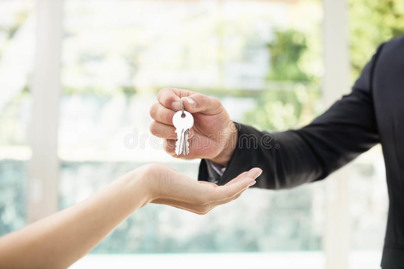 Real-estate agent giving keys stock photo