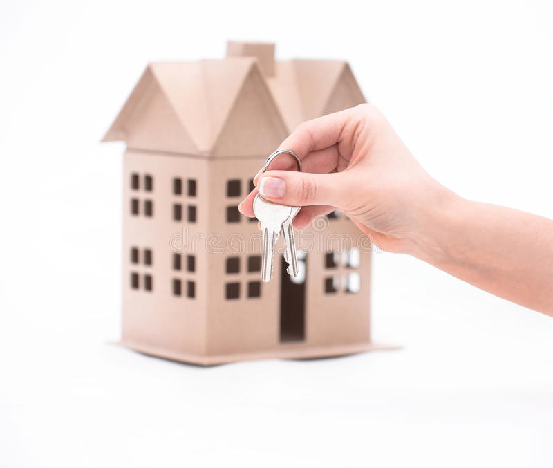 Real estate agent hand over property or new home keys to a customer on white. Real estate agent hand over property or new home keys to a customer royalty free stock photo
