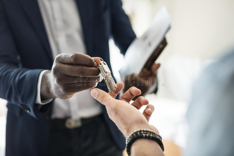 Real estate agent handing the house key to a client stock photography