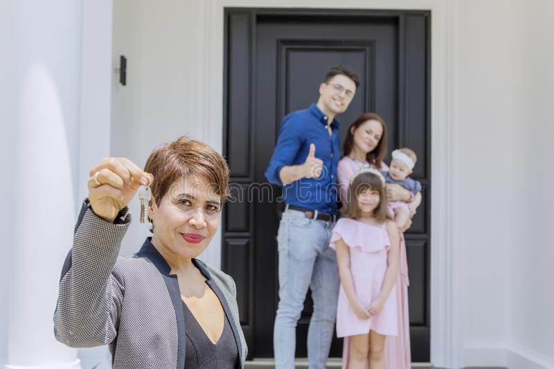 Real estate agent handing over keys to her client royalty free stock photo
