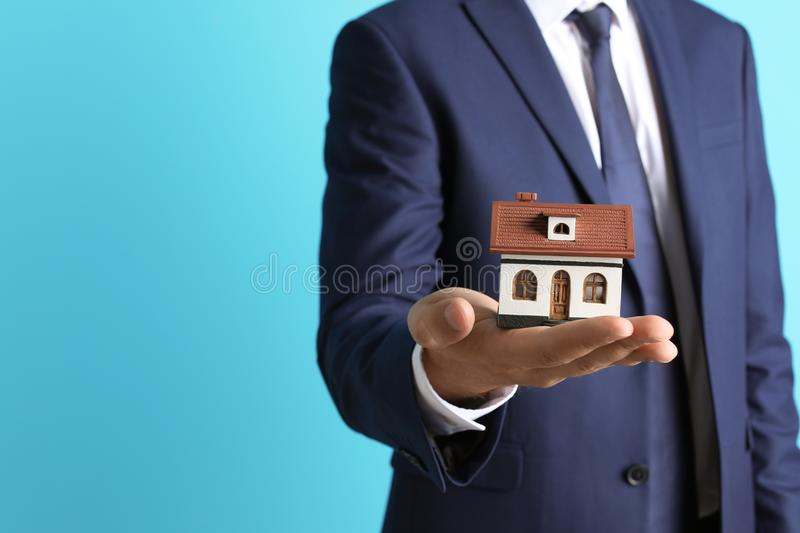 Real estate agent holding house model royalty free stock photos
