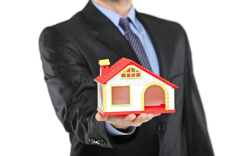 Download Real Estate Agent Holding A Model House In A Hand Royalty Free Stock Photos - Image: 14688928