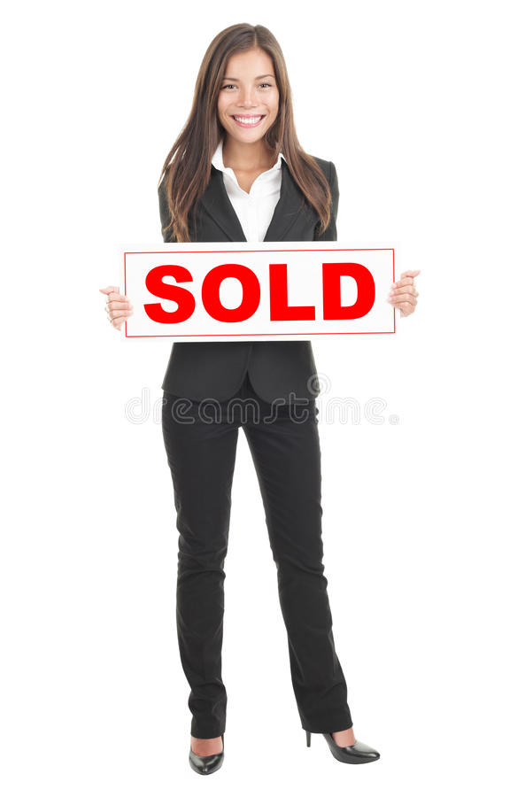 Real estate agent holding sold sign stock image