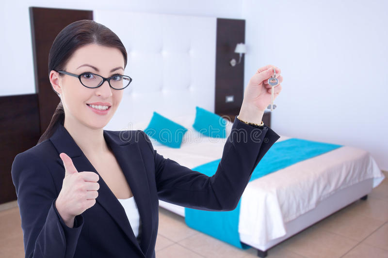 Real estate agent with key in modern flat stock photography