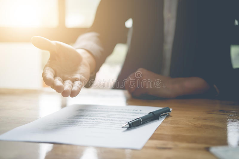 Real estate agent offer hand for customer sign aggrement contract signature. Real estate concept. Real estate agent offer hand for customer sign agreement royalty free stock photos