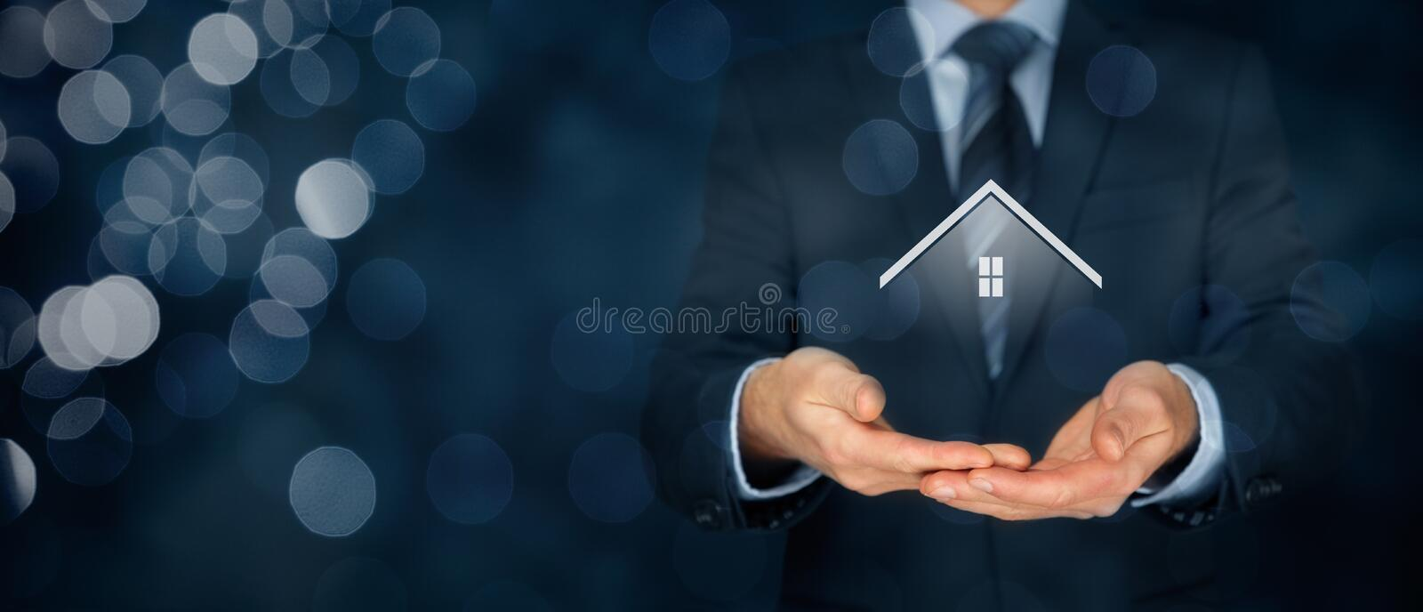 Real estate agent. Offer house. Property insurance and security concept. Wide banner composition with bokeh background royalty free stock photo