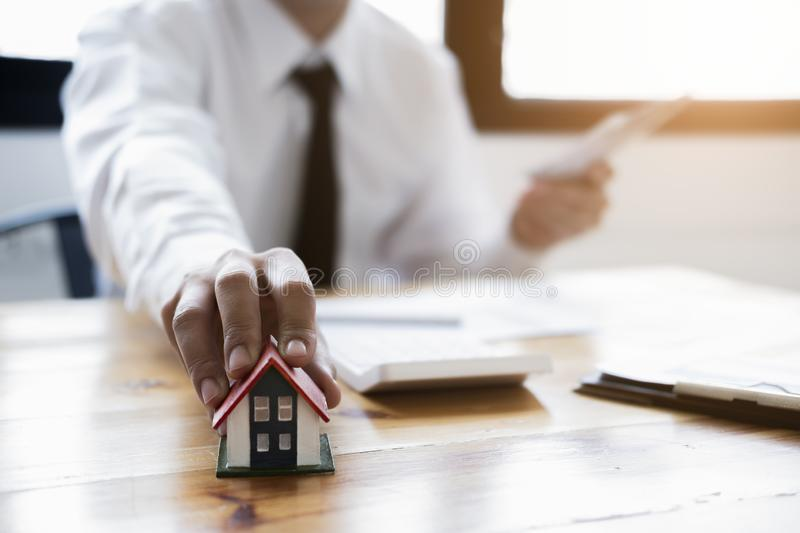 Real estate agent offer house represented by model. Real estate broker agent presenting and consult to customer to decision making stock photos
