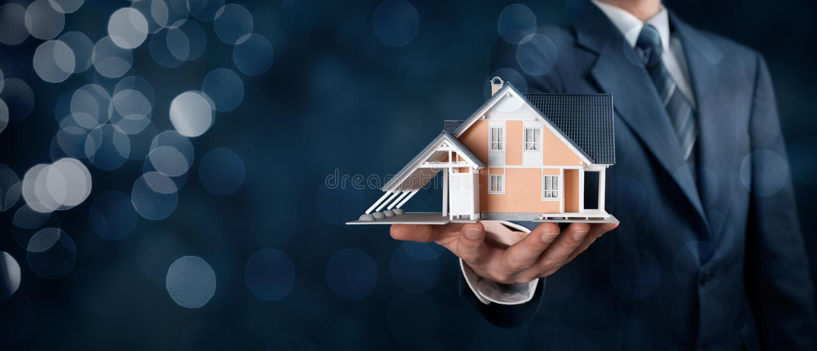 Real estate agent. Offer house represented by model. Wide banner composition with bokeh background royalty free stock photos
