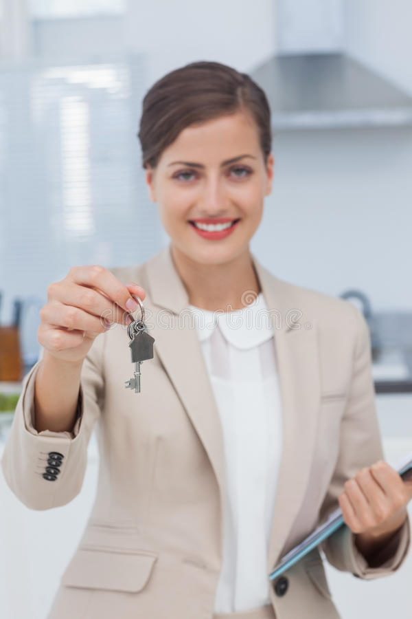 Real estate agent offering house key royalty free stock photography