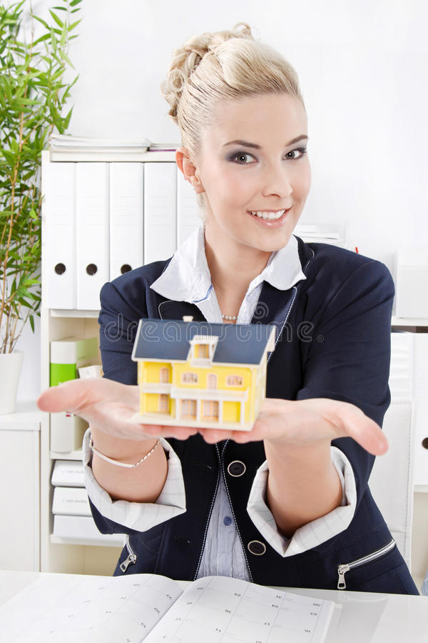 Real Estate Agent at office stock images