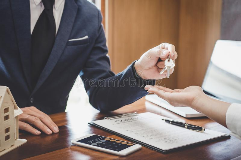 Real estate agent Sales manager holding filing keys to customer after signing rental lease contract of sale purchase agreement,. Concerning mortgage loan offer stock photo