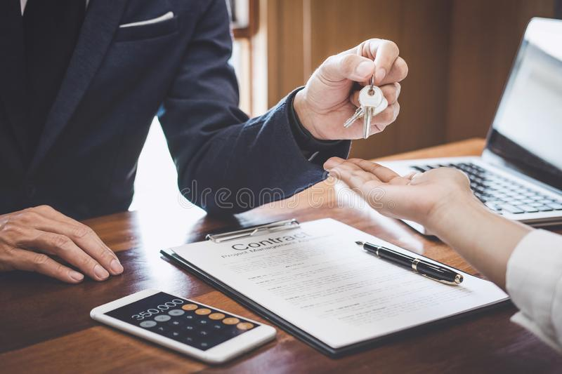 Real estate agent Sales manager holding filing keys to customer after signing rental lease contract of sale purchase agreement,. Concerning mortgage loan offer stock photos