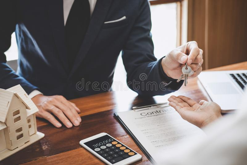 Real estate agent Sales manager holding filing keys to customer after signing rental lease contract of sale purchase agreement,. Concerning mortgage loan offer royalty free stock images