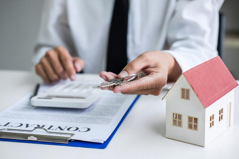 Real estate agent Sales manager holding filing keys to customer after signing rental lease contract of sale purchase agreement,. Concerning mortgage loan offer stock images
