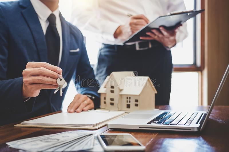 Real estate agent and Sales manager team analysis pricing of rental lease contract of sale purchase agreement, concerning. Mortgage loan offer for and house stock images