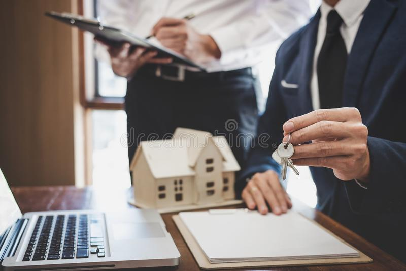 Real estate agent and Sales manager team analysis pricing of rental lease contract of sale purchase agreement, concerning mortgage. Loan offer for and house stock image