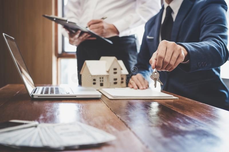 Real estate agent and Sales manager team analysis pricing of rental lease contract of sale purchase agreement, concerning mortgage. Loan offer for and house royalty free stock photos