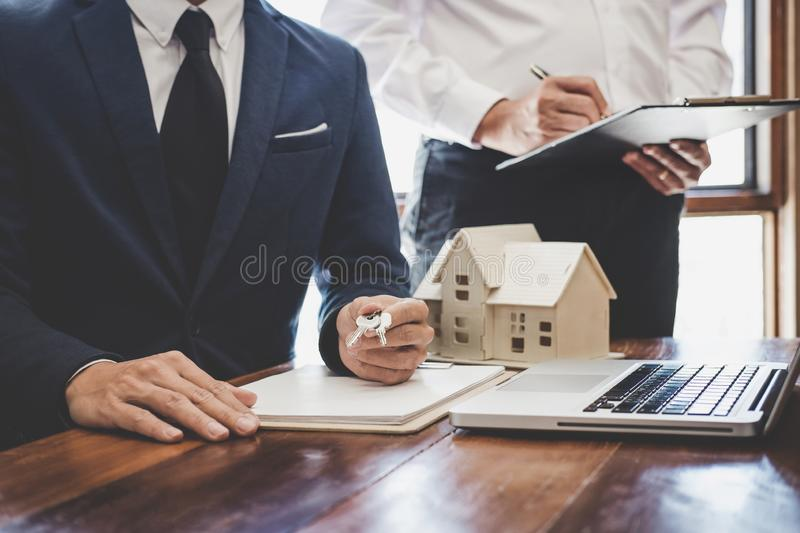 Real estate agent and Sales manager team analysis pricing of rental lease contract of sale purchase agreement, concerning mortgage. Loan offer for and house stock photos