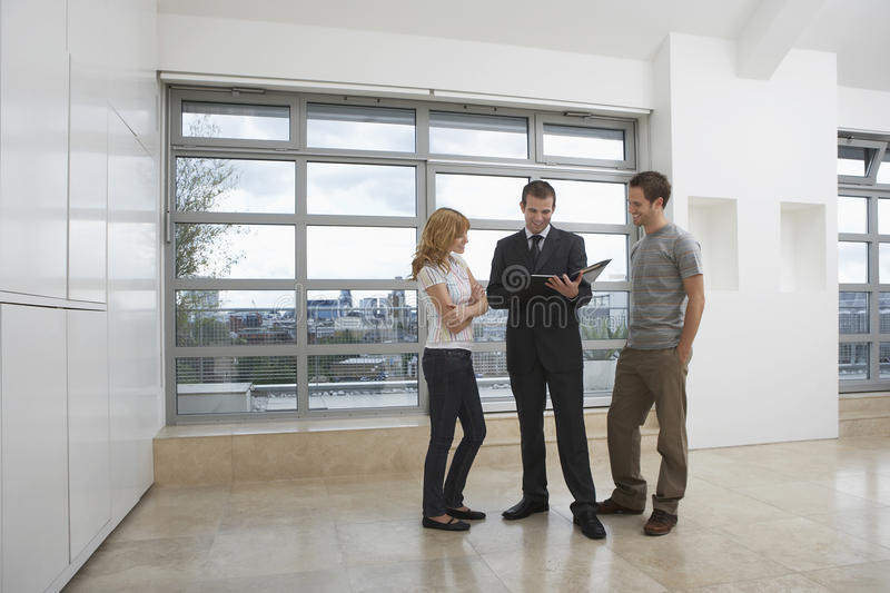 Real Estate Agent Showing Couple New Apartment royalty free stock photos