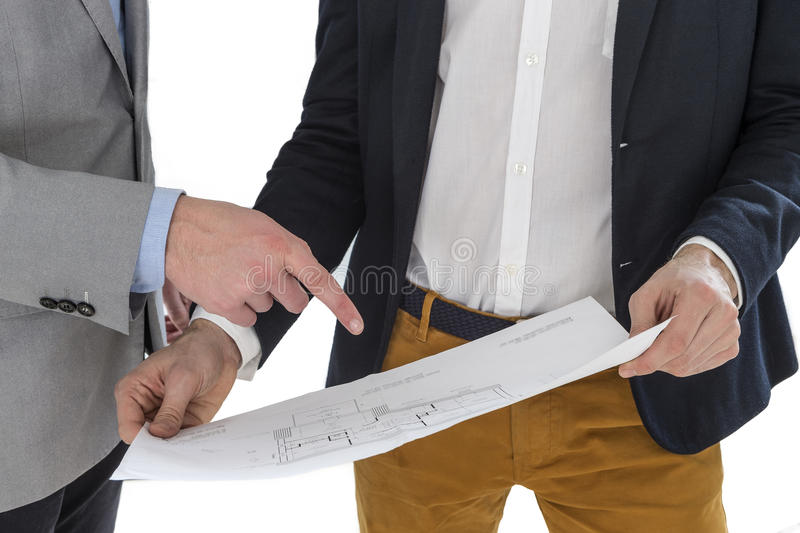 Real-estate agent showing house plans to a businessman. On white backgound stock photos