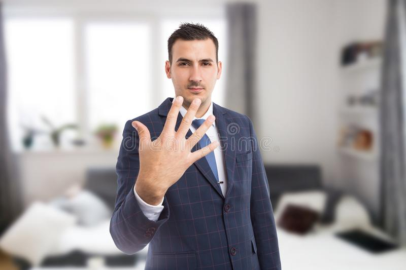 Real estate agent showing number five or fifth stock image