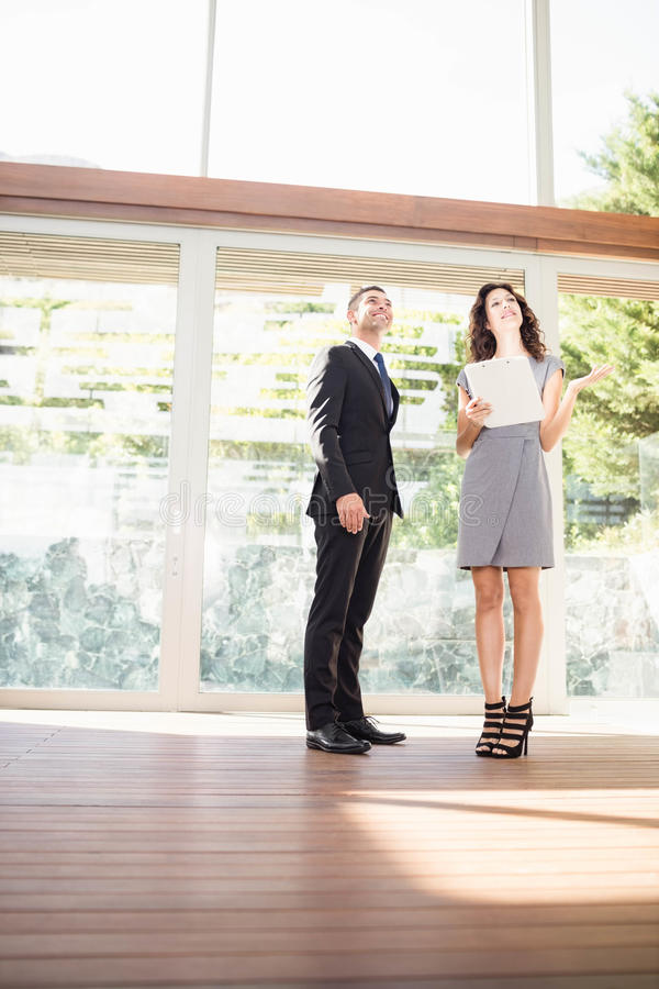 Real-estate agent showing young woman new home royalty free stock image