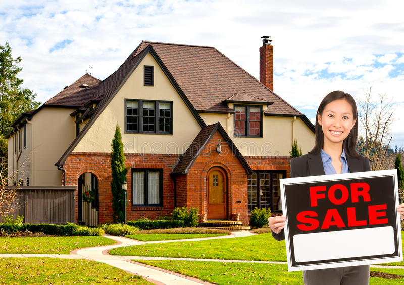 Real estate agent standing outside house stock image