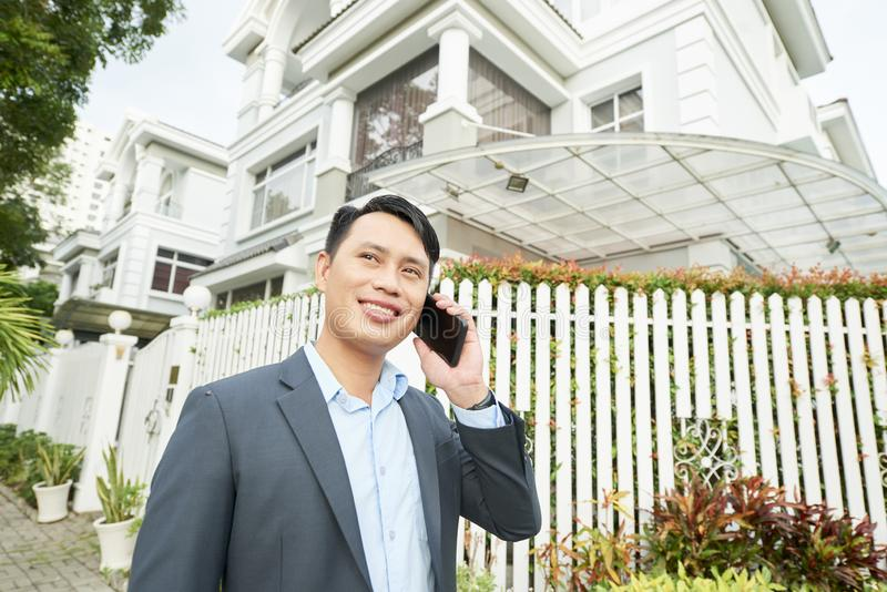 Real estate agent talking on the phone royalty free stock images