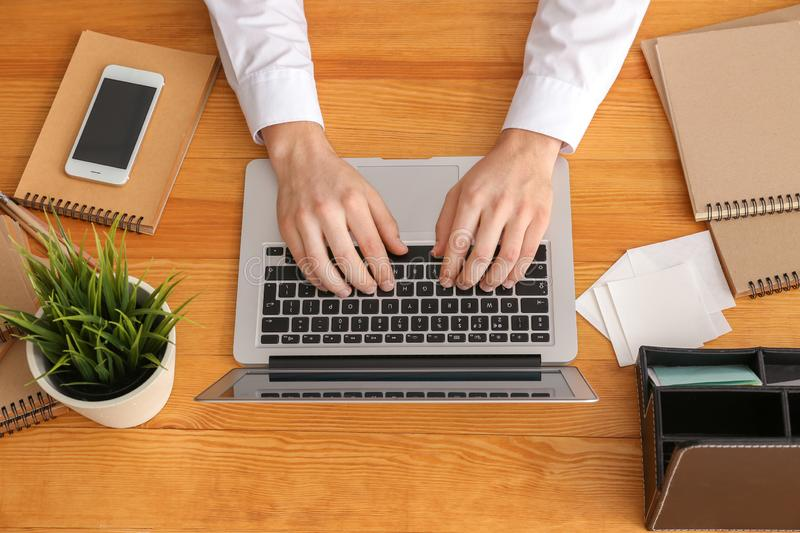 Real estate agent using laptop in office royalty free stock photos