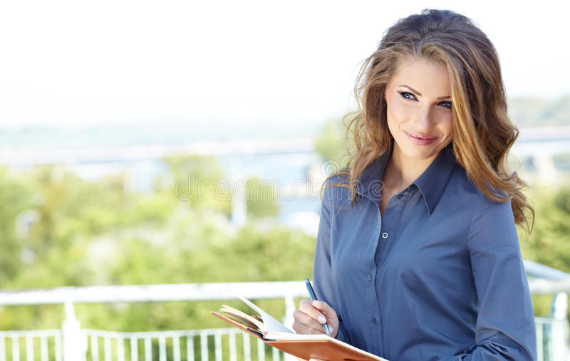 Real Estate Agent Woman. Attractive Real Estate Agent Woman stock photography