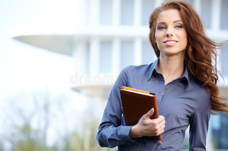 Real Estate Agent Woman. Attractive Real Estate Agent Woman royalty free stock photography