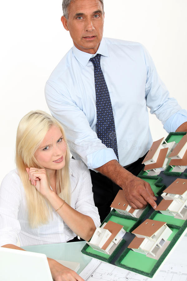 Real estate agents. Working at the office stock images