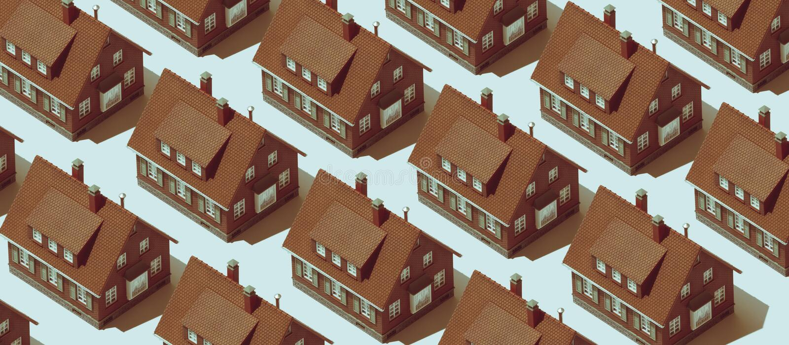 Real estate background with repetition of model houses stock photography