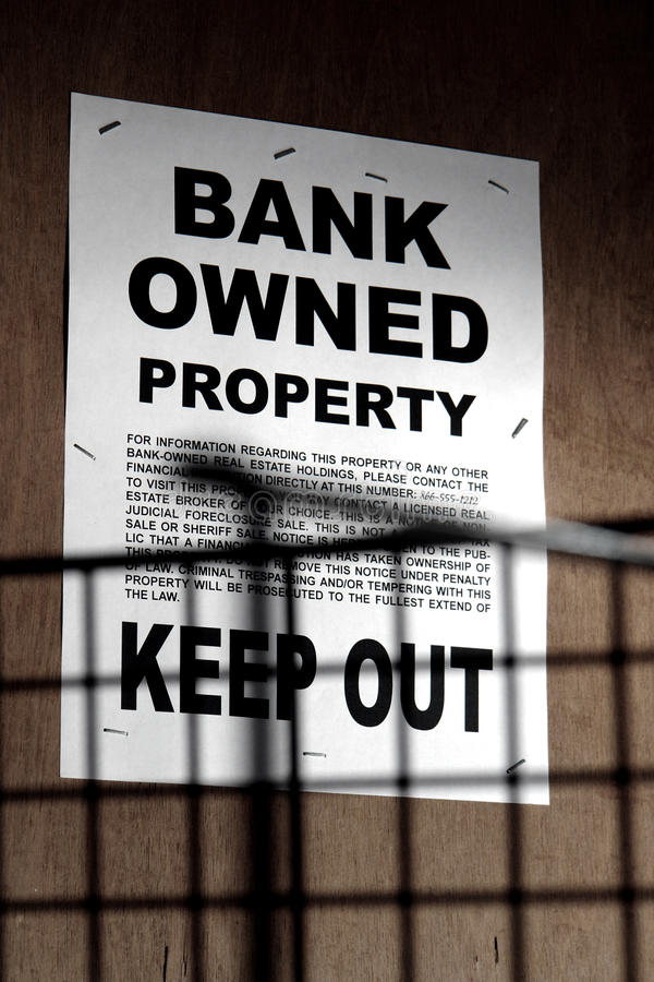 Download Real Estate Bank Owned Sign On Boarded Up Building Stock Image - Image: 12434879