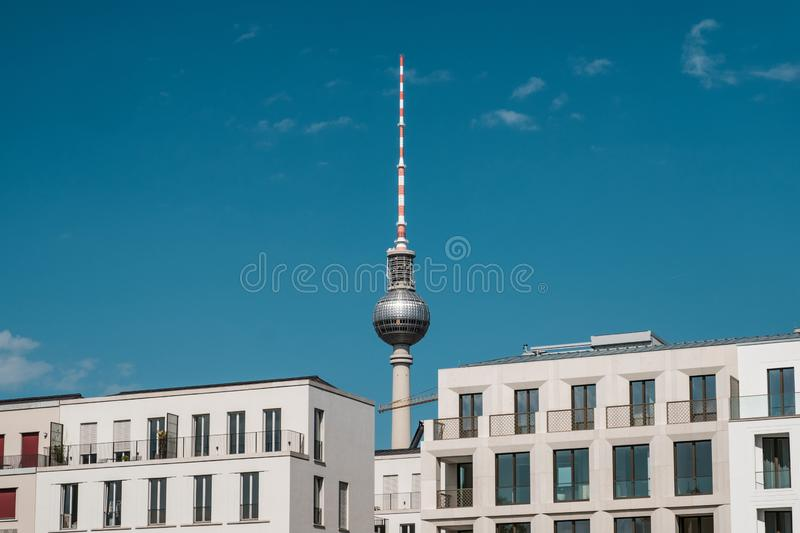 Real estate in Berlin concept - apartment buildings and tv tower.  royalty free stock image