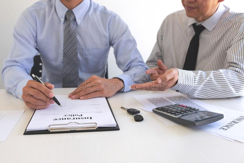 Real estate broker agent presenting and consult to customer to decision making sign insurance form agreement, home model,. Concerning mortgage loan offer for royalty free stock photo