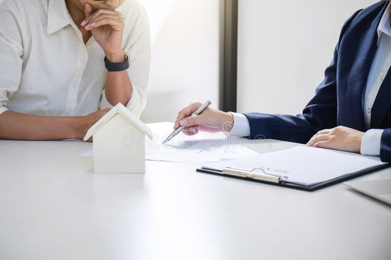 Real estate broker residential agent being analysis and making t. He decision a home estate loan to customer and waiting for reply to finish house and car rent royalty free stock photo