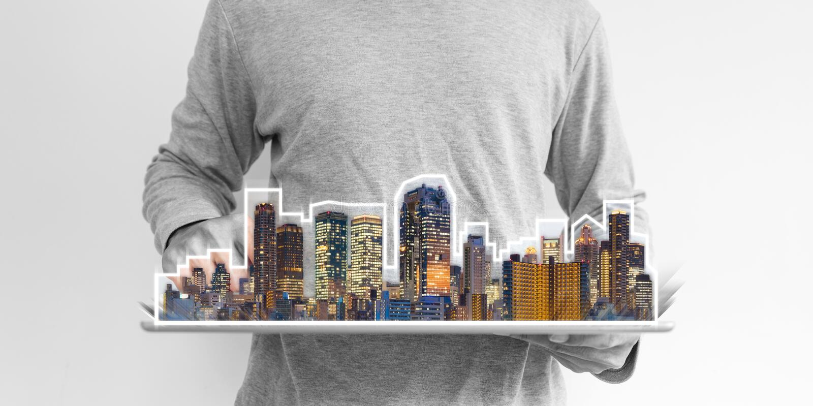 Real estate business, building technology and smart city. a man using digital tablet with buildings hologram. Real estate business, buildings technology and stock images