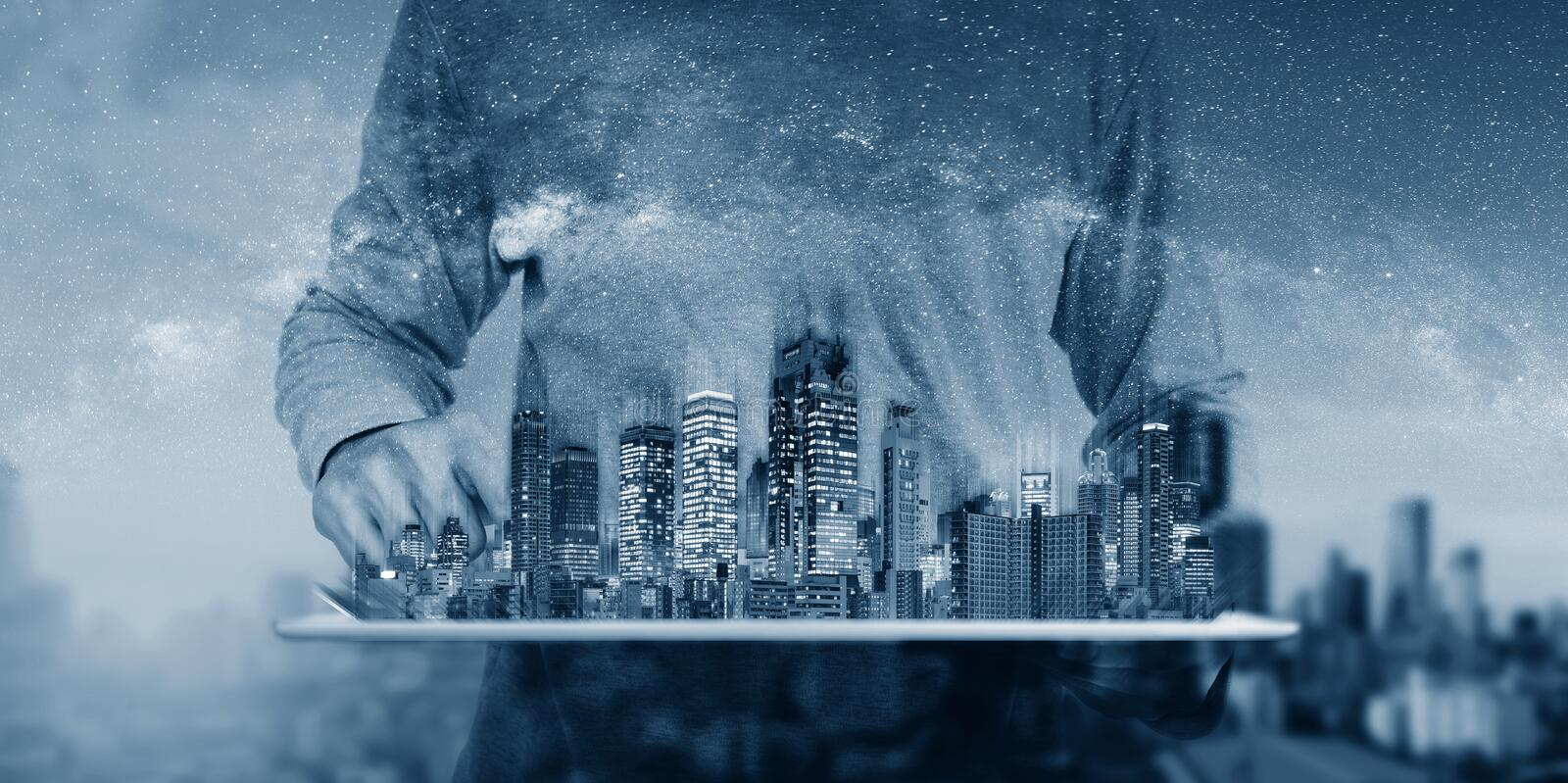 Real estate business and investment, building technology. a man using digital tablet with buildings hologram stock image