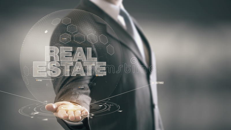 Real Estate Businessman Holding in Hand New technologies. Businessman in the future with futuristic technology stock images
