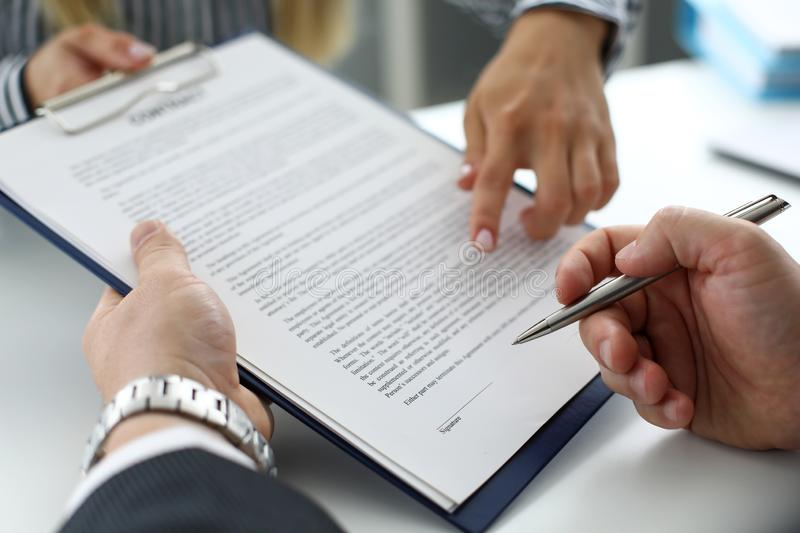 Real estate clerk offering visitor document to sign stock photography