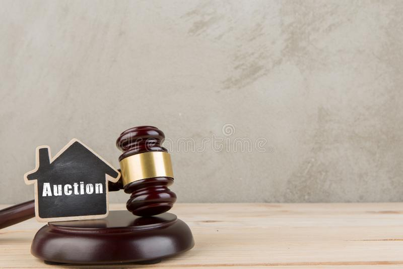 Real estate concept auction gavel and little house with inscription Auction. Real estate concept -auction gavel and little house with inscription Auction, rent stock photos