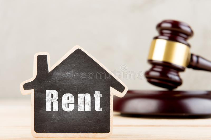 Real estate concept -auction gavel and little house with inscription Rent. Home, housing, rental, property, residential, architecture, label, miniature, offer stock image