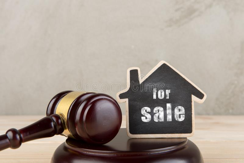 Real estate concept -auction gavel and little house with inscription For Sale. Rent, home, housing, rental, property, residential, architecture, label royalty free stock image