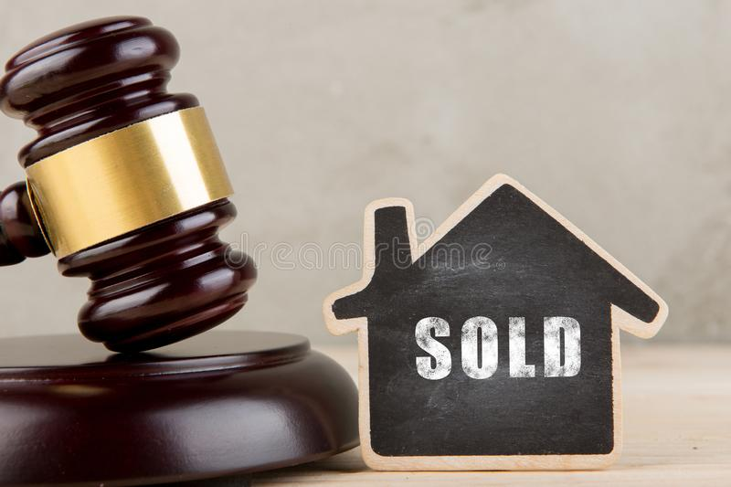 Real estate concept auction gavel and little house with inscription Sold. Real estate concept -auction gavel and little house with inscription Sold, rent, home royalty free stock photos