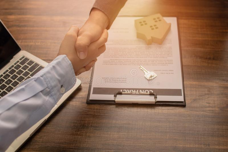 Real estate concept, Banker agency shake hand with client or house buyer after successful communication and sign contract.  stock photos