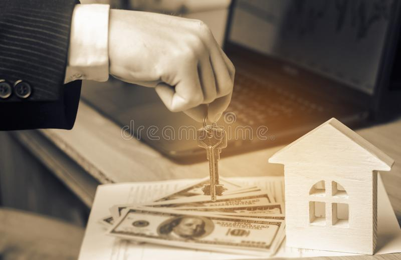 Real estate concept. Buying and selling homes. Rent apartment. S. Ale of property. Mortgage and payment of taxes. Debt and loan. Purchase. Home sold. Realtor and stock photography